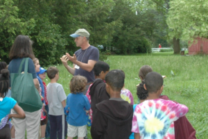 Grounds Manager Lloyd Guindon engages elementary students from Friends' Central School - click to enlarge